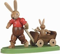 rabbit dad with son in a handcart