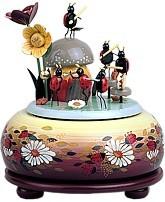 small play tin making music beetles